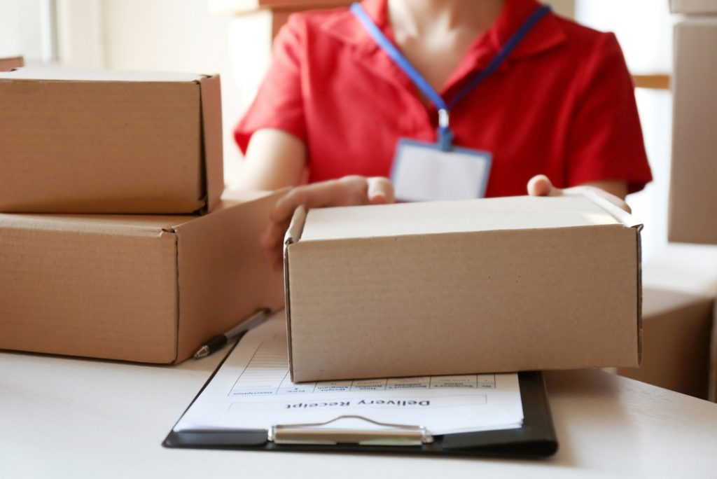 Office Setting Send & Collect Person Handing Over Parcels