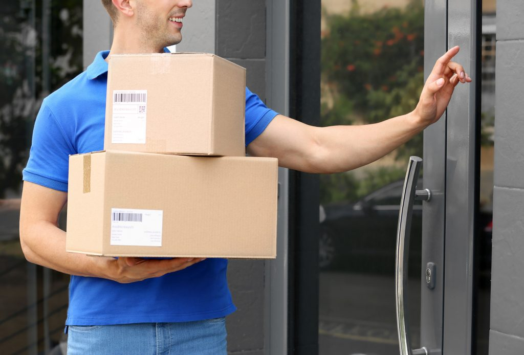 Courier delivering and pressing Bringme Bell
