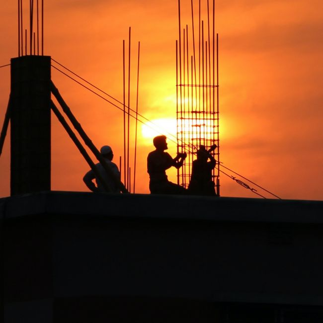 Silhouette of men in construction site during sunset 176342